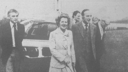 Mrs Thatcher being escorted from her helicopter by Mr Bob Aveling Chairman of the Isle of Ely Conser