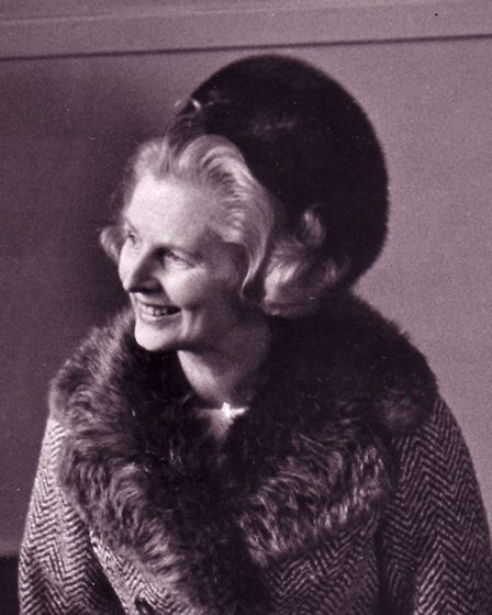 Mrs. Thatcher ideally dressed for Norfolk with a warm fur-trimmed top coat and simple, elegant day d