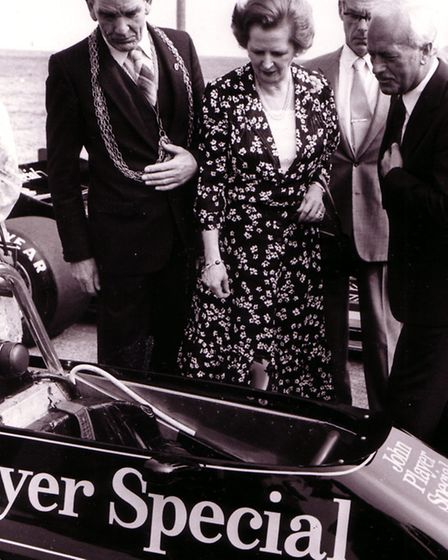 Mrs. Margaret Thatcher is shown the Formula One 88 Lotus racing car by Mr. Colin Chapman, Managing D