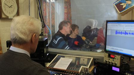 Volunteers record the latest issue of a talking newspaper