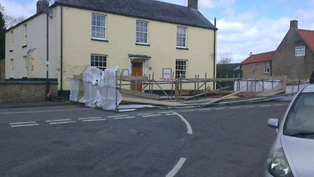 High winds send the scaffolding tumbling into the road. Picture: Michael Candy