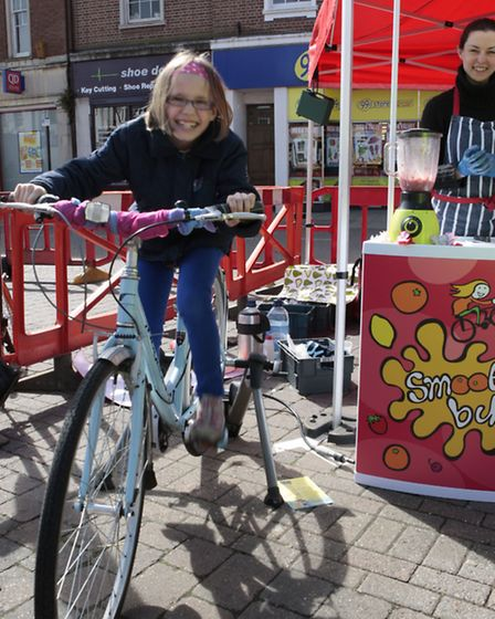 Wisbech Cycle Day . Emily Hamilton peddling hard to make her fruit smoothy