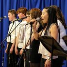 Esme Smith sings, accompanied by fellow vocalists and 'Dysfunktion'.