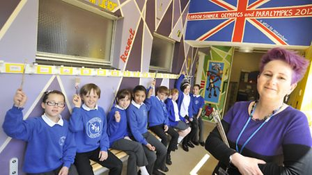 Stretham Primary School Olympic Mural, pupils with Teaching Assistant Kim Smith, also a local artist