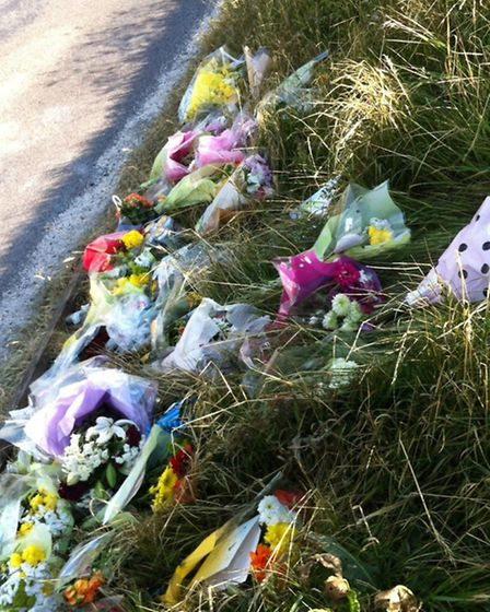 Flowers left on the bank at the side of the road