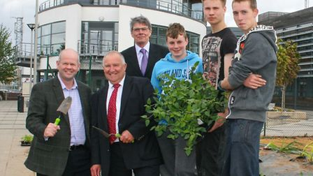 Wayne Eady, far left, with Councillors Melton and Seaton, and the Delamore apprentices.