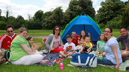 A family enjoying a picnic at the Big Lunch at Cressing Temple
