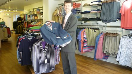 Andrew Cox inside his new High Street shop