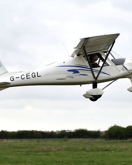 Flying club at Chatteris airfield. Flight in a Microlight. Ikarus C42 taking off.