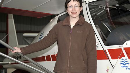 Flying club at Chatteris airfield. Flight in a Microlight. Katie Denham next to her shared Ikarus C4