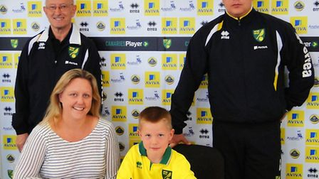 Ben Collier signing a new contract at the Norwich City Academy.