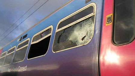 The smashed windows of the train