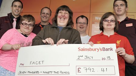 Cheque presentation for FACET at Sainsbury, March.
