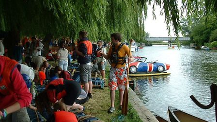 Raft builders gather on the riverside