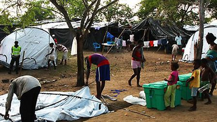 ShelterBox tents are erected by people displaced on the hilltop above Barranca Vieja, Northern Colom