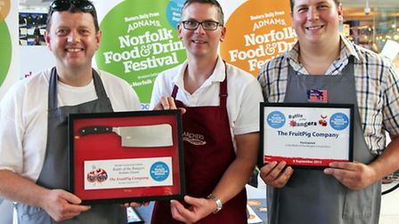 The Fruit Pig Company, winners of the Battle of the Bangers butchers' choice, with judge and 2011 wi