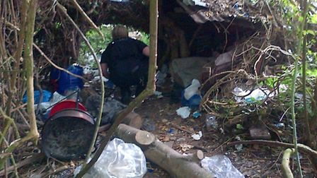 Police discovered a rough sleeper's den in the woods off Harecroft Road.