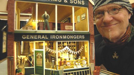 Trevor Vincent and the model he created of JH Adams shop in Littleport.