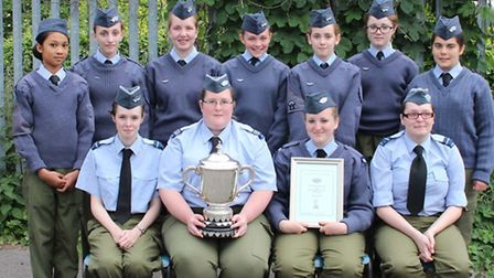 The Wisbech unit of the GVCAC with thier trophy.