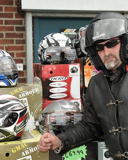 2 Wheel Junkie charity event and sale. Del Godfrey with the selection of helmets.