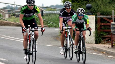 Riders travel through Pondersbridge during the Circuit of the Fens cycle race.