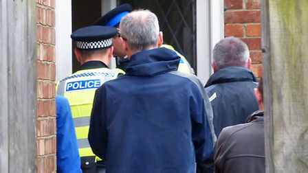 Officers entering the house in Colvile Road, Wisbech.