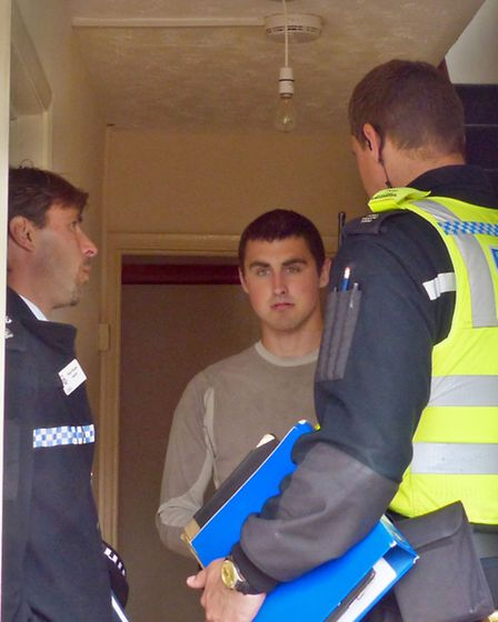 Insp Robin Sissons and PCSO Aivaras Krochalev speak to a migrant worker living at the house in Clare