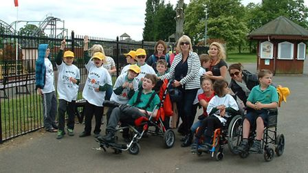Pupils, their carers, teachers and teaching assistants, with Rotarians at Wicksteed Park.