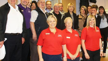 FDC Leader Cllr Alan Melton and Cllr Pop Jolley with members of the council's leisure team and perso