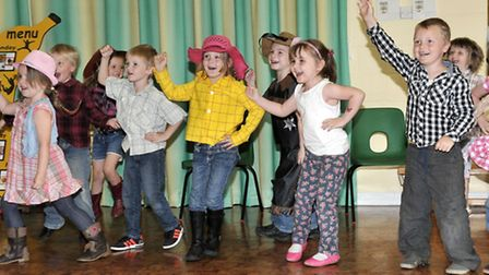 New Road Primary School, Whittlesey. Held a dress up and dance event in aid of Macmillan.