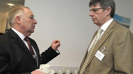 Fenland District Council leader Alan Melton, left, talking to deputy leader Cllr Chris Seaton at the