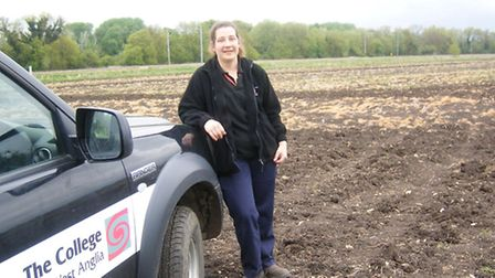 Cambridge campus agricultural director Linda Kirby shows the land being used to grow maize.