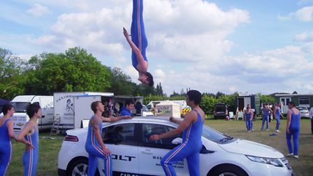 Gymnasts vaulting WH Brand's Chevrolet Volt at the Deeping Agricultural Show.