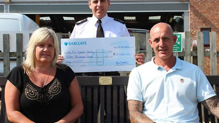 Tim West and Sheena McClelland, from Ramsey, presented the cheque to Cambridgeshire Fire and Rescue