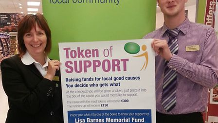 Store relief manager Ian Chapman and colleague Vicki Bullock urge you to use your token of support t