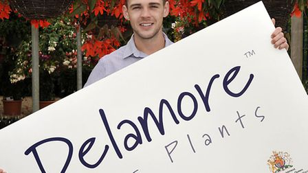 Adam Parry from R.Delamore Ltd Wisbech with their Royal Warrant.