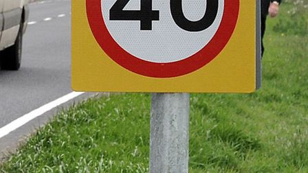 Traffic passing the new 40mph speed sign.