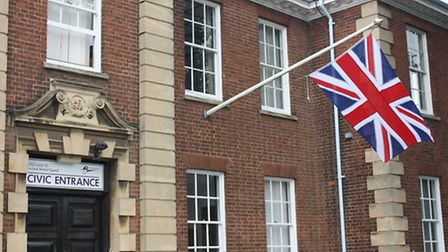 The Union Flag flies outside Fenland Hall in celebration of the birth of the royal baby.