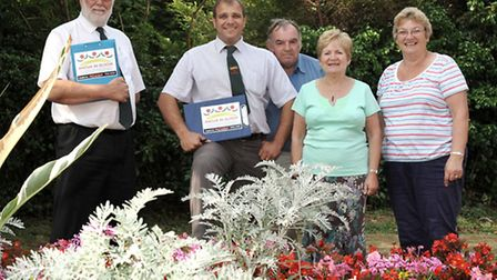 Anglia in Bloom judging at the Garden of Rest March. Left Judges Brian Gardner,Oliver Deeming and re