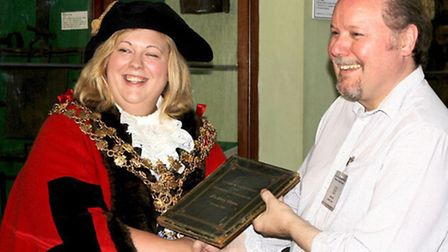 Wisbech Society returns Victorian book to the town. Wisbech Mayor Samantha Hoy presenting the book t