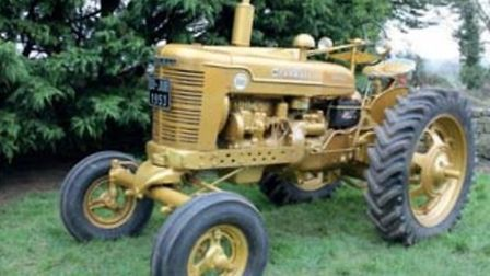 A gold-painted diesel tractor
