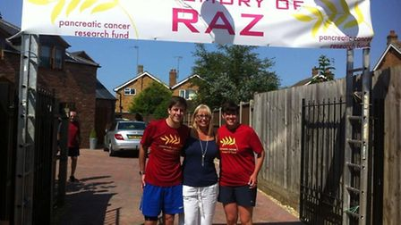 Gavin Caney and his twin sister Kelly King with Alan's wife, Lindsey (centre) at the end of the tria