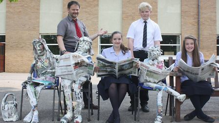 (Left to right) The winning sculpture, the 'It girl', art teacher Peter Harrison, who organised the