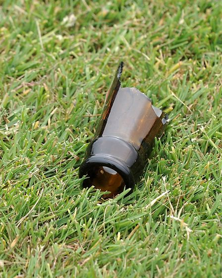 Broken bottles and rubbish left on the grammar school rugby pitch.