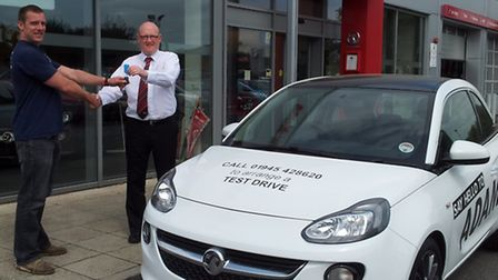 Ben Greer receives the keys for the car at Thurlow Nunn, Wisbech.