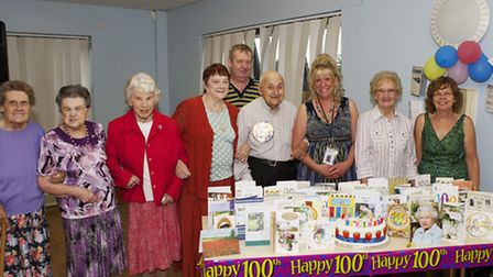 Jim Huggins, fourth right, with party organiser Angie Sawer, third right, centre users, family and f