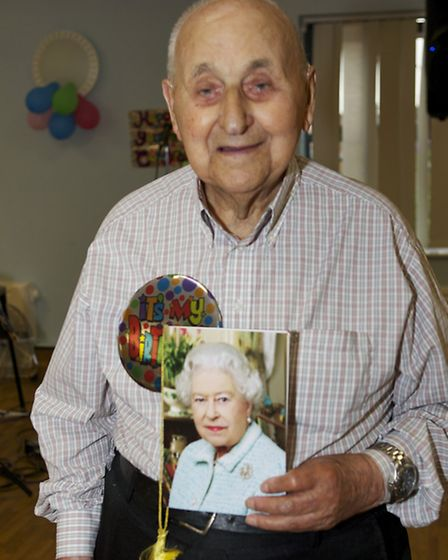 Jim Huggins with his 100th birthday card from the Queen. Picture: ROGER RAWSON