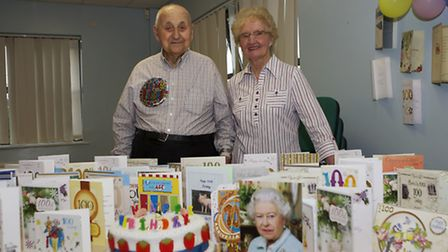Jim Huggins with Molly Bryan, who baked the celebration cake. Picture: ROGER RAWSON