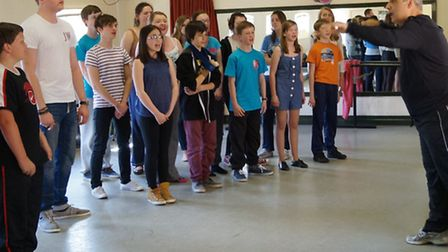 Peter Polycarpou with students at the Angles Theatre, Wisbech