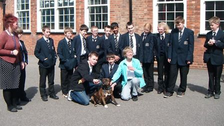 Zak and his dog Taz with pupils at a Lincolnshire school